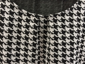 Pleats at the centre front