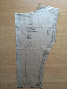Back bodice piece, folded along seam line and cut on the fold.